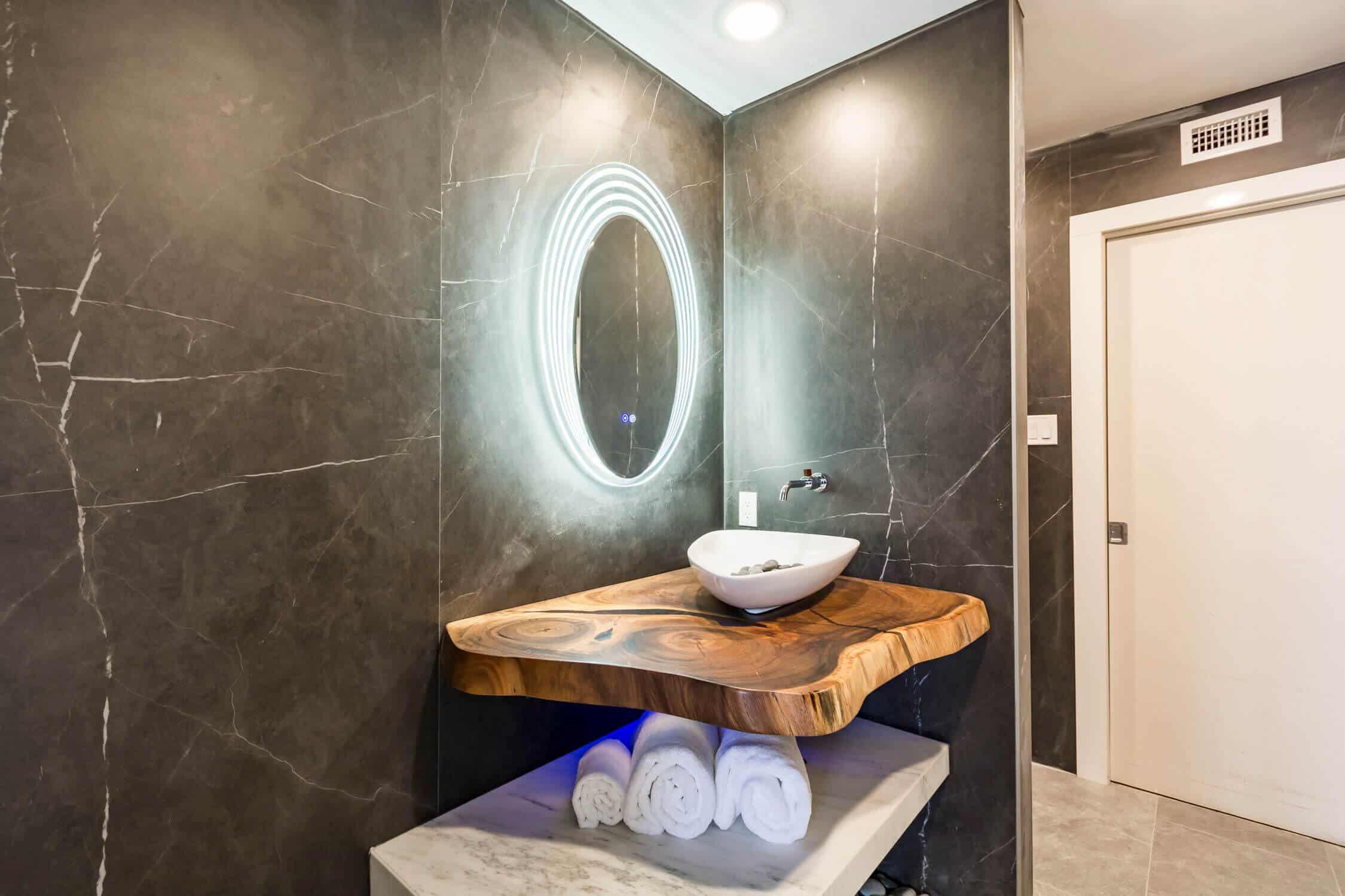 bathroom with lights on mirror