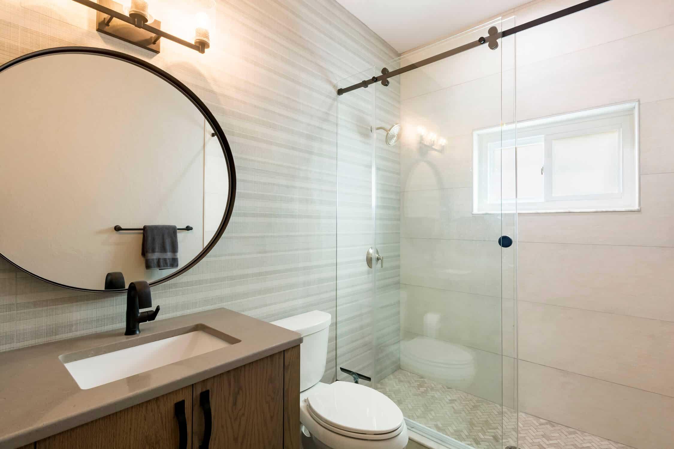 Bathroom featuring full wall tile