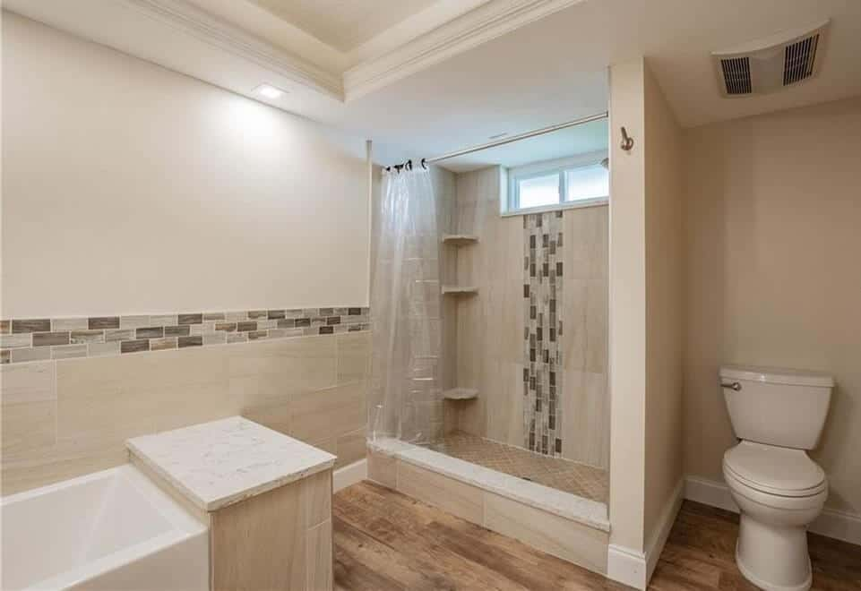 bath condo remodel featuring coordinated shower and wall tile
