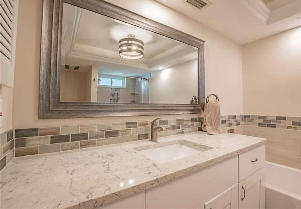 condo bath remodel featuring granite countertops