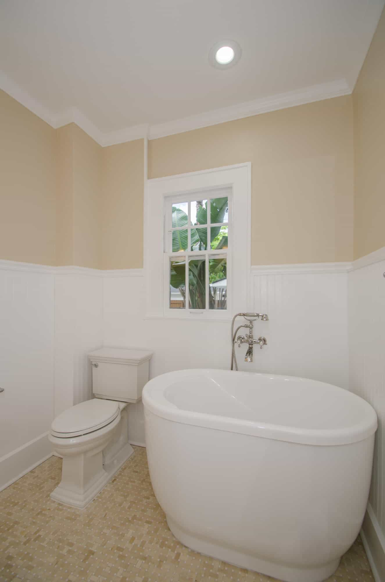 vintage style bath remodel featuring free standing tub