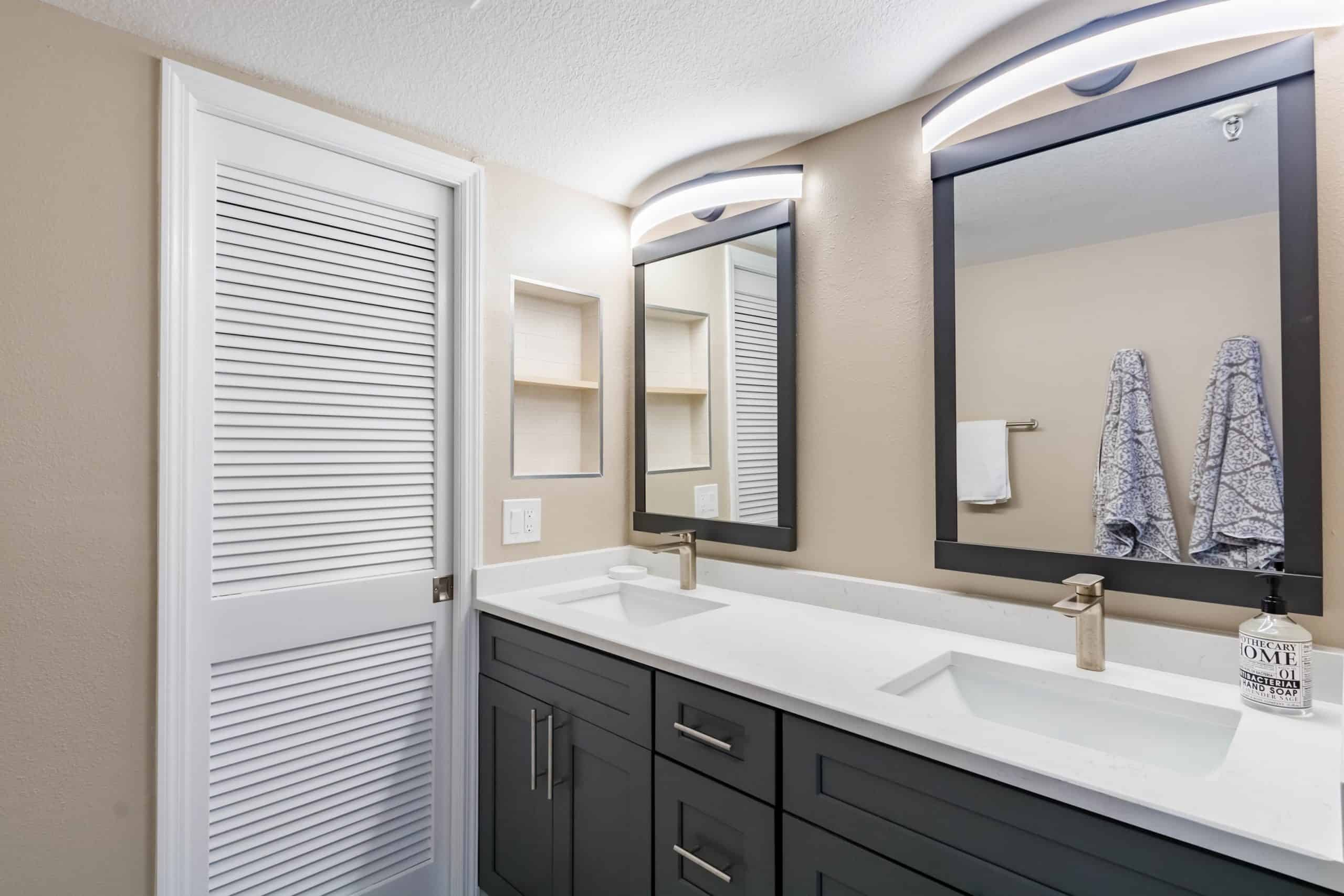 bathroom remodeling in pelican beach with 2 mirrors